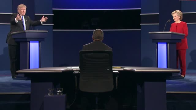 Democratic Party presidential candidate Hillary Clinton and Republican Party presidential candidate Donald Trump discuss their judgment skills as...