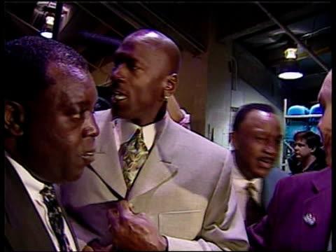 Democratic race for president ITN Michael Jordan along Bradley talking with man Bradley signing basketball Howard Baker interview SOT Being a...