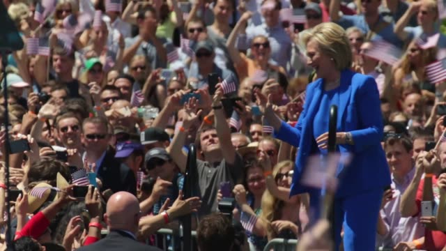 Democratic US presidential hopeful and former US Secretary of State Hillary Clinton greets supporters as she walks up to the stage during her...