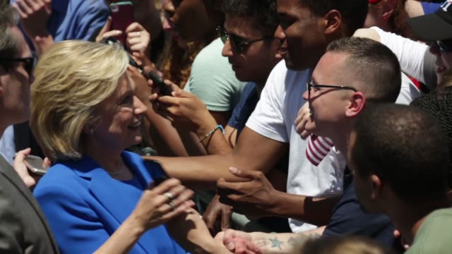 Democratic US presidential hopeful and former US Secretary of State Hillary Clinton greets supporters during her campaign kickoff rally New York City...