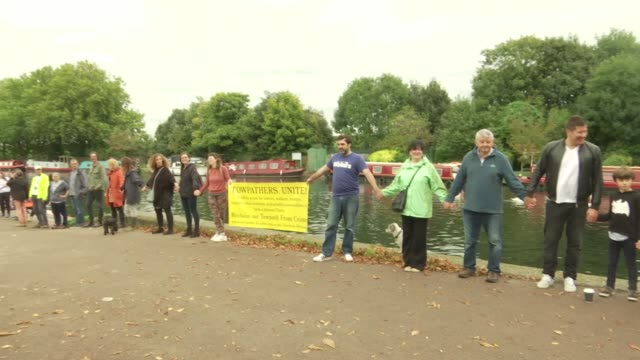 Demonstration against London canal towpath crime ENGLAND London Hackney Springfield Park EXT Members of local community stand on River Lea towpath...