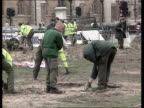 London AntiCapitalist Protests Aftermath ENGLAND London Westminster EXT Workman cleaning graffiti off the statue of Sir Winston Churchill after...