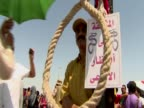 A demonstrator holds a halter and a placard waiting for former Egyptian President Hosni Mubarak trial verdict