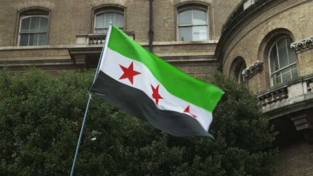 A demonstrator waves a Syrian Flag during a Stop The War Coalition protest outside Downing Street on December 12 2015 in London England Stop The War...