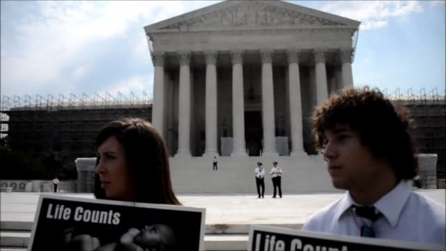 Demonstrators against the Obama administration's health care reform protested outside the Supreme Court on Monday ahead of expected ruling Thursday...
