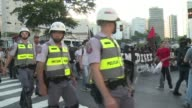 Demonstrators and police clash in Sao Paulo during the first in a planned series of antiWorld Cup protests across Brazil called by radical activist...
