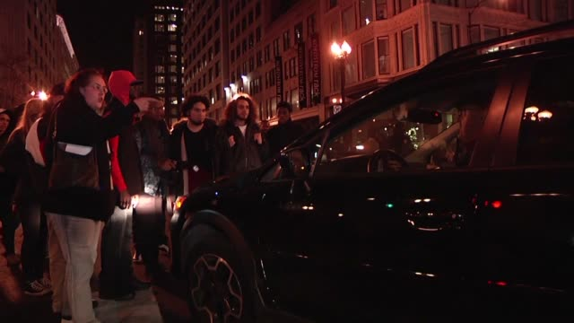 Demonstrators block a downtown intersection in Chicago and confront motorists as they protest over the death of Laquan McDonald