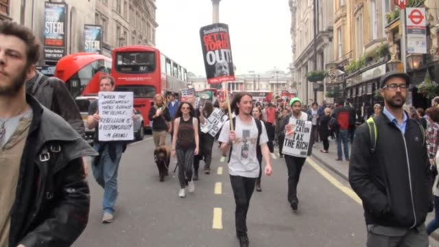Demonstrators hold banners and poster as they take part in 'End Austerity Now' protest which starts outside Downing Street in London United Kingdom...