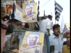 Demonstrators hold flags and posters of Osama Bin Laden during a protest in Pakistan