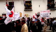Demonstrators marched in colonial town of Quito against labor reforms of Ecuadorian President Rafael Correa
