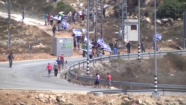Demonstrators protest against the construction of Jewish housing units and the separation wall in the Nabi Salih region of Ramallah West Bank on...