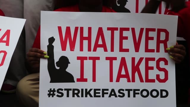 CU TU Demonstrators protest for an increase in wages for fast food and home care workers during the morning rush hour on September 4 2014 in Chicago...
