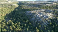 Dense woods on the west coast of Norway are seen from the air. Available in HD.