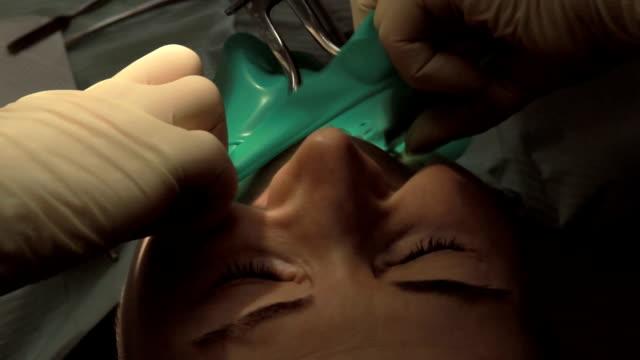 Dentist and assistant making dental filling