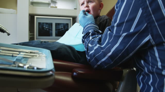 dentist examining a little boy