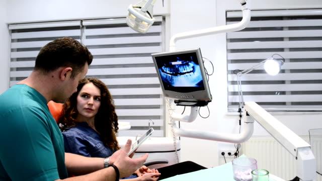 DOLLY: Dentist informing patient via digital tablet