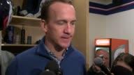 Denver Broncos quarterback Peyton Manning held a locker room interview about being the backup quarterback to Brock Osweiler after returning to...