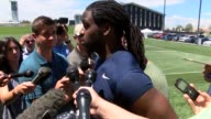 Denver Broncos running back Jamaal Charles talks with the press after practice on the second day of training camp at the team's practice facility