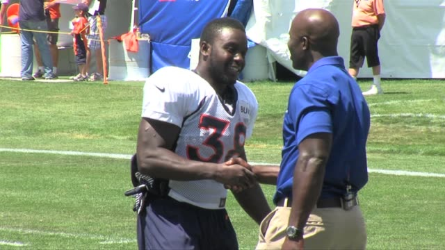 Denver Broncos running back Montee Ball met his football hero in former running back Terrell Davis at training camp Aug 2 2013 Montee Ball meets...