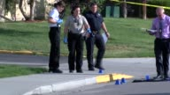 Denver Police investigated a fatal shooting in southeast Denver neighborhood Members of the crime scene unit take photos and video and mark the scene...