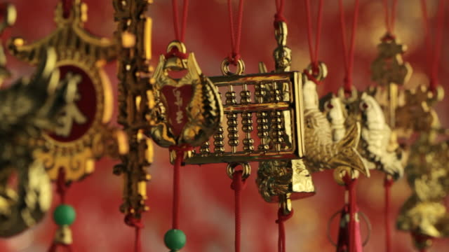 CU Depicting gold decorations hanging from red strings / Singapore, Singapore, Singapore