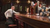 HD DOLLY: Depressed Businessman Leaving The Bar