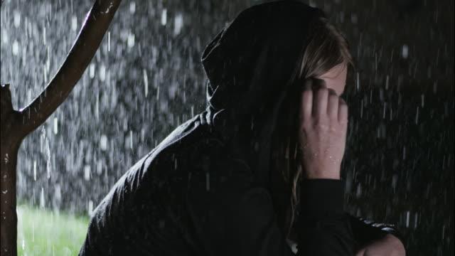 Depressed girl in the rain