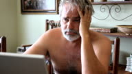 depressed man at laptop