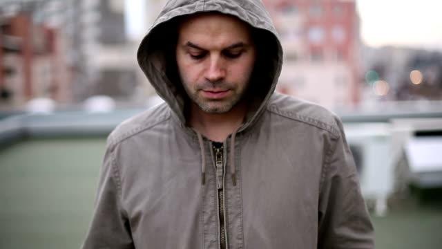 Depressed man walking outside
