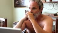 Depressed man with laptop