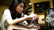 Depressed teenage girl using mobile phone.