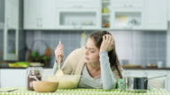 Depressed woman in the kitchen