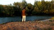 Depressed young man look at river