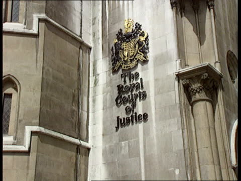 High court judgement CF ENGLAND London Royal Courts of Justice LMS Iris Bentley along towards from court to camera LA MS Sign 'The Royal Courts of...