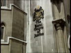 High court judgement NAF ENGLAND London Royal Courts of Justice LMS Iris Bentley along towards from court to camera LA MS Sign 'The Royal Courts of...