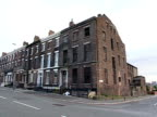 Derelict Georgian terraced houses on a street in Liverpool 2000