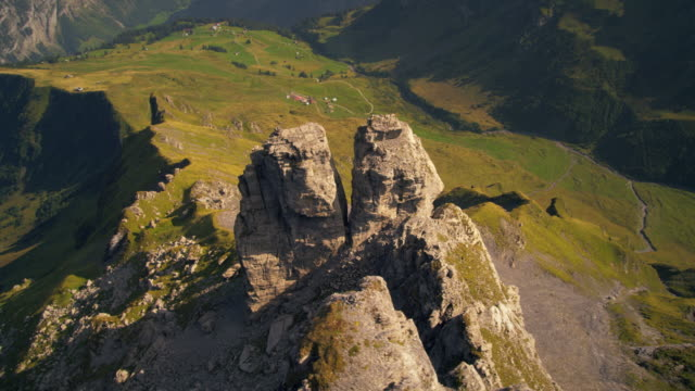 Descending dolly shot of rock formation near the Swiss alps