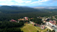 Descending drone shot of an empty ski resort during the summer