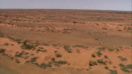 Desert shrubs dot the vast outback in northern Queensland. Available in HD.
