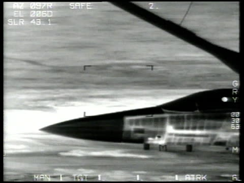 Desert Storm / AERIAL Aircraft flying with scud launcher / AERIAL Crosshairs on exploding target / Iraq
