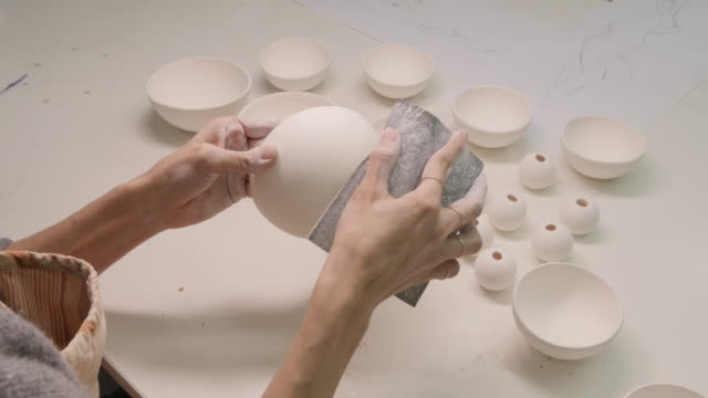 Design Studio. Young Woman making Art and Craft Product