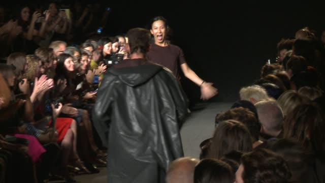 Designer Alexander Wang runs down the runway during Alexander Wang Runway Spring 2015 MercedesBenz Fashion Week at Pier 94 on September 06 2014 in...
