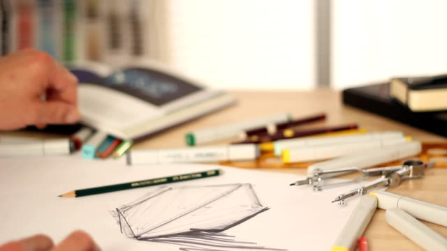 Designer drawing and sketching