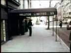 Designer Halston running down street and stopping underneath awning for Halston Limited 33 / Halston interviewed about 1970s fashion Halston...