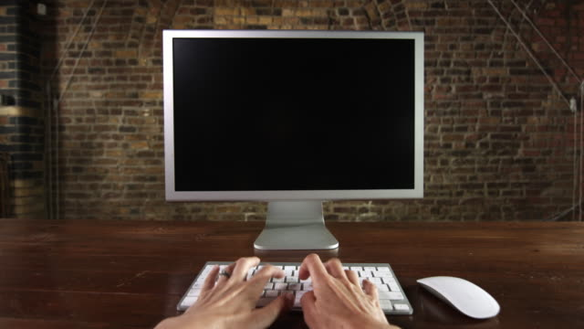 POV desktop computer screen and typing