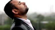 Despaired Businessman In The Rain