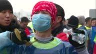 Despite air pollution levels in Beijing rated as hazardous by the US Embassy about 30000 runners gathered in the city to take part in the annual...