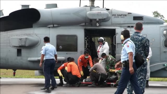 Despite being hampered by rough seas the search for bodies from the AirAsia Flight 8501 crash site continued on Sunday