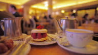CU Dessert and tea cup being filled in traditional Parisian tea room, Paris, France