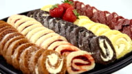 Dessert tray baked strawberry and cream filled Swiss Roll Cakes.